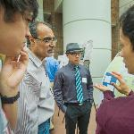 Janak Thapa '13 (right) talks with Physics Professor Narendra Jaggi about his work.