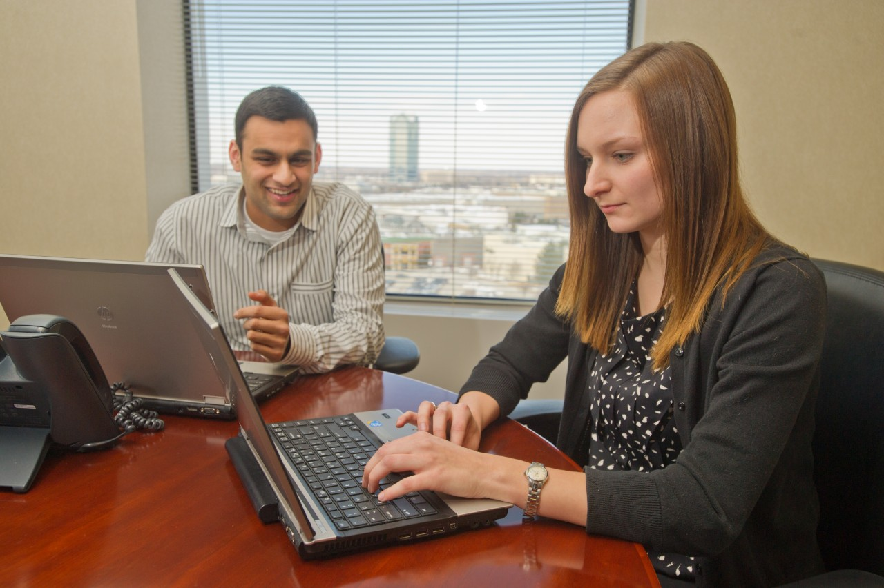 Two accounting students working during an internship at Deloitte's Chicago office.
