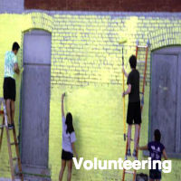 volunteers painting a building exterior