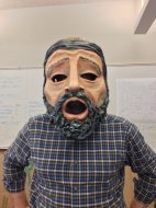 Curtis Trout Wears Tragic Mask he made for Greek Plays