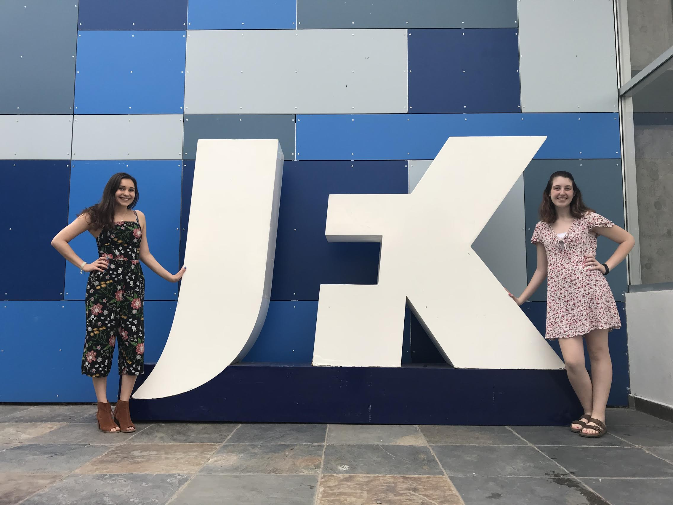 Allison and Maddie standing by the JFK school sign