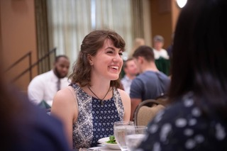 Katherine Henebry laughing at a formal dinner