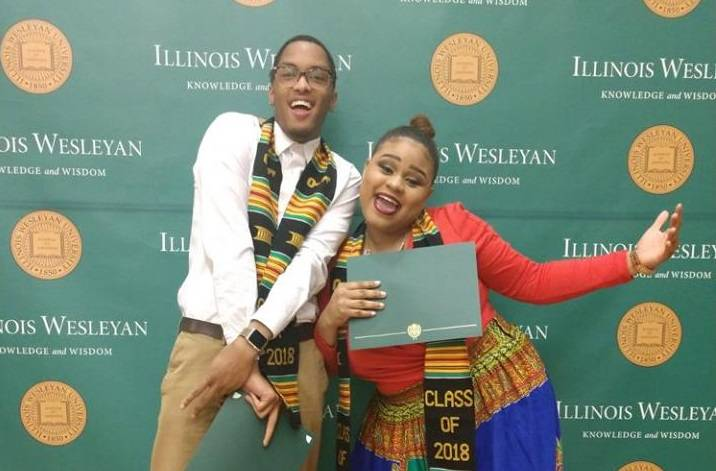 Two students smile and pose for camera, celebrating their graduation at the Multicultural Graduation event.