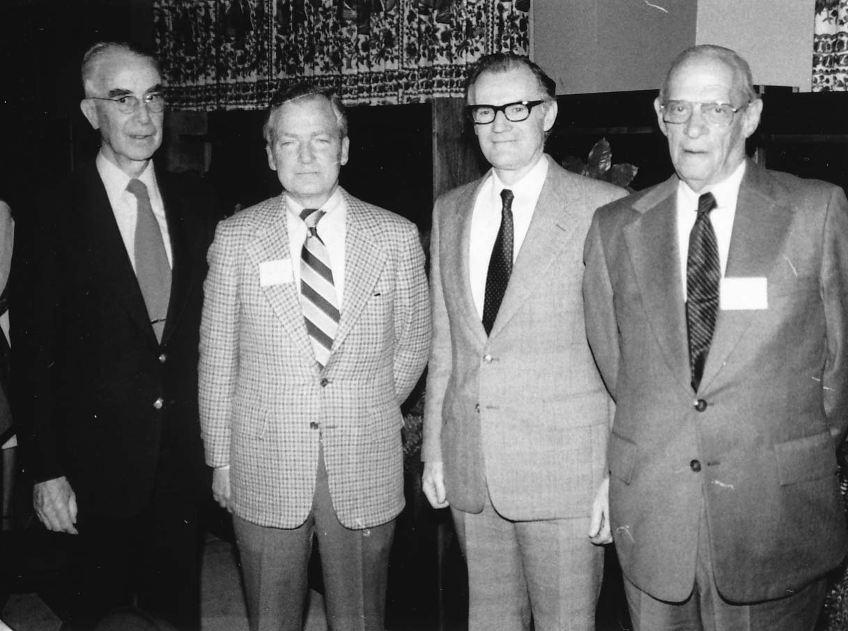 1980 Board of Visitors, L to R: Robert Tate, Marvin Bower, Robert Eckley (IWU President), and Herbert Livingston