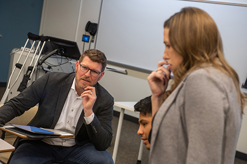 Talluto works with Illinois Wesleyan Instructor and Director of DTE Tara Gerstner '01 and students in an upper-level DTE course he co-teaches.