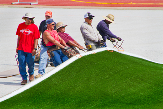 Crews install artificial turf at Wilder