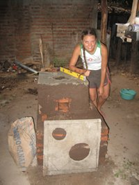 Byrne with the eco stove she built