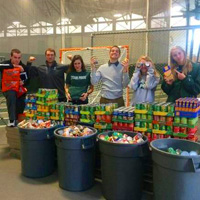 Student-Athletes Collect Cans for Clare House