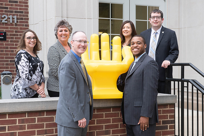Career Center staff with Handshake hand