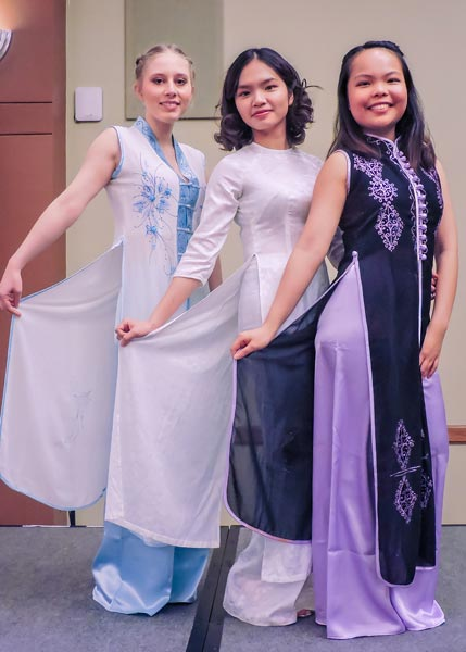 Lena Kincaid '19 (far left), Linh Le '19, and Ngan Pham '19 strike a pose after performing the Vietnamese Nón Lá Dance