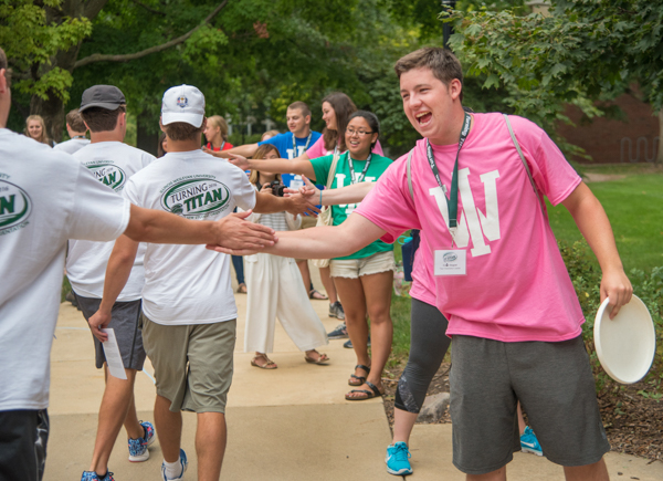 Titan Orientation Leader (TOL) Colin Gogoel '18 formed a celebratory gauntlet of other TOLs as the Class of 2020 left the ceremony