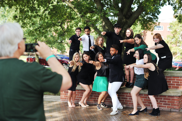 Members of the IWU student a capella group silenceinterrupted strike their best album-cover pose while family and fans record the moment